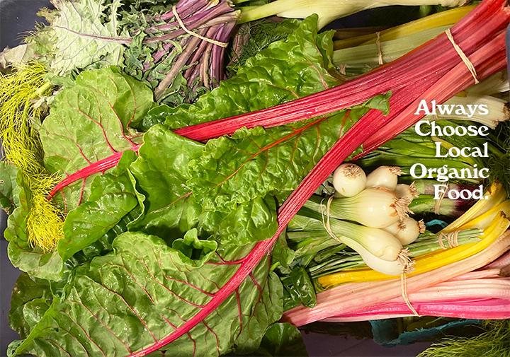 always choose organic produce text over a background of fresh chard, onions, arugula, and beet greens
